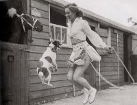 Woman and dog jumping rope, ca. 1940s.jpg